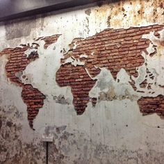 Concrete and brick wall make up this world map wall design. Metal beam above. All of them are materials for Industrial Design and related styles. Map is a reference to travel, which is also an element of the style. - Welcome My Decor Design Weekend, World Map Mural, World Map Wall, Wall Design, House Design, Deco Cool, Plaster Walls, Brick Walls, Exposed Brick