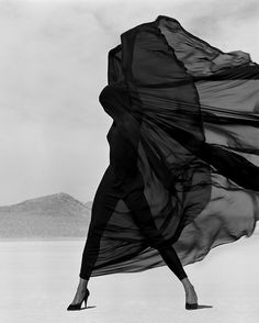 Veil as dress, dress as body - #HerbRitts 1990 campaign for #Versace gloried in classicised figures, graphic poses and dramatic clothing.  Shot at #elMirage in the #mojavedesert, Versace's black gowns and bodysuits became bold forms set against pale sand and baking heat.  #gianniversace #1990sfashion #fashionhistory #vintagefashion #dresshistory