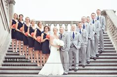 I really like the way they inverted the usual 'wedding party picture' by placing the bride and groom in the front. I love thiiis!