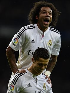 """"""" Real Madrid's Portuguese forward Cristiano Ronaldo (down) and Real Madrid's Brazilian defender Marcelo celebrate after scoring a goal during the Spanish league football match Real Madrid CF vs Rayo. Real Madrid Football Club, Football Is Life, Football Match, Rafael Nadal, Marcelo Real, Cristiano Ronaldo Quotes, Real Madrid Wallpapers, Good Soccer Players, Neymar"""