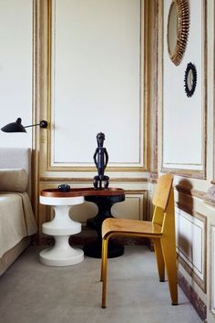 North of the Seine, in a dress-circle locale overlooking the 8th arrondisement's exquisite Parc Monceau is where style arbiter Emmanuel de Bayser has his Parisian pied-à-terre.  A pair of 'Low Senat' armchairs from Pierre Jeanneret's Chandigarh collection, a wooden stool with ceramic bowl, and a Jean Prouvé 'Métropole Visiteur' chair surround a mirrored coffee table by Ron Arad. A 1950s floor lamp by Serge Mouille near the win...