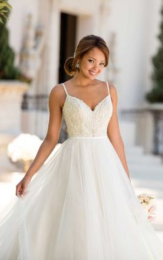 One of the most unique pieces in this collection, this flirty ballgown wedding dress from designer Stella York is just plain fun!