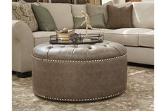 39 X 39 The Wilcot Ottoman from Ashley Furniture HomeStore (AFHS.com).