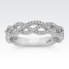 This contemporary 14 karat white gold wedding ring features a unique woven infinity design. Ninety round pavé-set diamonds, at approximately .27 carat total weight, have been hand-matched for exceptional beauty and brilliance.