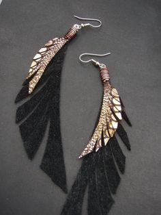 Leather Feather Earrings - Sparkly Gold, Bronze and Black Dangly Earrings. $40.00, via Etsy.