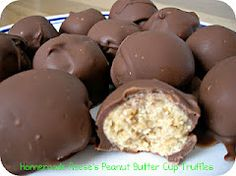 Homemade Reese's Peanut Butter Balls.   We make something almost exactly like this at Christmas to give as gifts, when we have the time!  The only difference in our version is we add shredded coconut.  They are great, and super cute if you put a little dot of colored frosting on the top after the chocolate sets.