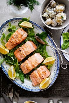 Roasted wild Scottish salmon fillet with dill pickle potato salad. by Darren Muir for Stocksy United