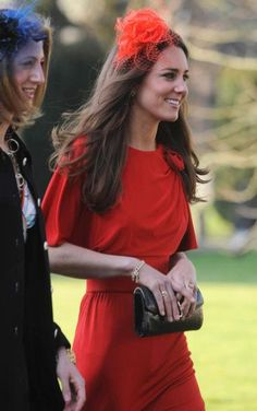 April 17, 2010 - Prince William and Kate attended the wedding of David Jardine-Paterson and Emilia D'Erlanger. Kate wore a red dress by Issa and a red fascinator. She accessorized the outfit with a black clutch and black heels.