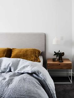Grey Sheets, White Light, Wooden Side Table, Grey Headboard, Brown Pillows