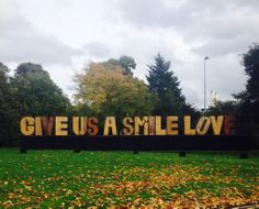 Give Us A Smile Love - entrance to the Affordable Art Fair in London's Battersea Park