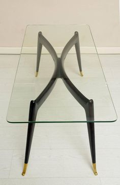 Slender and elegant Italian 1950's coffee table Gio Ponti style. | From a unique collection of antique and modern coffee and cocktail tables at https://www.1stdibs.com/furniture/tables/coffee-tables-cocktail-tables/
