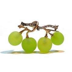 A Gold and Diamond-Set Grape Brooch by Fonesque et Olive.