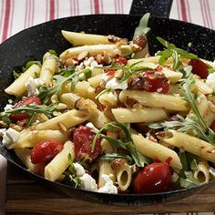 pasta salad with rucola and feta. I always add some sliced black olives and use pinenuts instead almonds. Delicious!