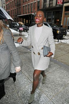 lupita nyong'o street style. all in the same color: coat, dress and ankle boots
