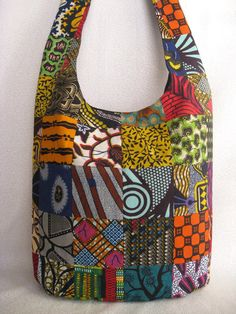 African print patchwork sling bag/ethnic purse/bright multi-color hippie/bohemian bucket bag/black lining from BohoRain on Etsy. Saved to Boho Rain bags. African Quilts, African Textiles, African Fabric, Ankara Bags, African Accessories, Patchwork Bags, Fabric Bags, Africa Fashion, Printed Bags