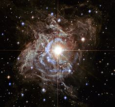 Bright Southern Hemisphere star RSPuppis is swaddled in a cocoon of reflective dust in this Hubble image. http://hubblesite.org/newscenter/archive/releases/2013/51/