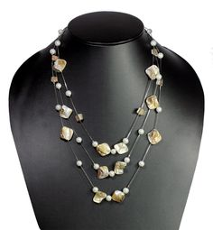 Khoobsurati Pearl White Precious Flintstones Medium Multichain String Necklace. It is very classy and sophisticated. This necklace is for those who love to flaunt a stylish look, but also want a trendy look.  Visit for buy this lovelly Neckstring:- http://khoobsurati.com/khoobsurati/khoobsurati-pearl-white-precious-flintstones-medium-multichain-string-necklace