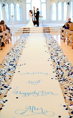 """Start your """"happily ever after"""" on the right foot with a beautiful aisle runner surrounded by rose petals"""