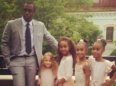 Dr Sean 'Diddy' Combs, with daughters all in Pale Cloud SS14