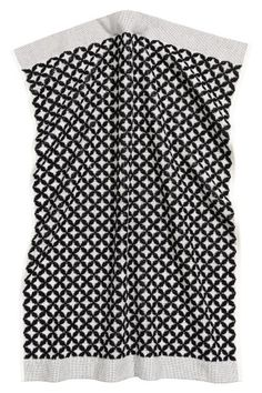 Geometric patterned black and white hand towel in jacquard-weave cotton terry £5 | H&M