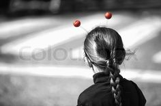 Girl with red balls antennas observes the Carnival parade of comparsas at Badajoz City, Spain | Stock Photo | Colourbox on Colourbox