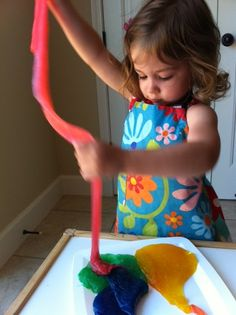 Making SLIME from clear glue, liquid starch and food coloring. So easy and fun!