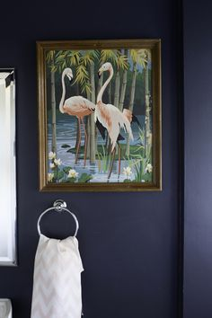 flamingo paint-by-number art in the blue bathroom | tiffany wendel house tour via coco+kelley