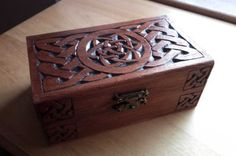 celtic knotwork carved on a wooden box