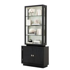 Black Finish | White Interior | Clear Glass | Nickel Hardware The Eichholtz Avenue Montaigne cabinet features a deep black finish, six glass shelves, and four d