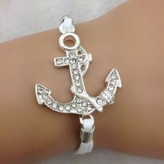 ⬇Bling Anchor bracelet✨7 available✨ Cute sparkly anchor bracelet on white cords. Has adjustable chain on the back. New in package Jewelry Bracelets