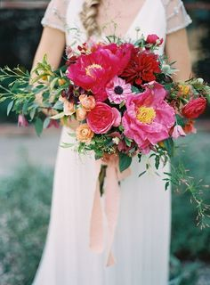 Beautifully vibrant pink and red wedding bouquet; Featured Photographer: Michael Radford Photography