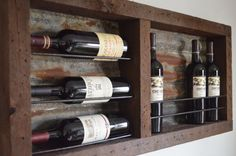 Reclaimed wine rack  with rusted tin barn by BarrelsAndBarnWood