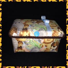 Large jungle theme diaper wipe case.