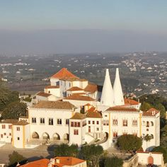 Sintra National Palace, #Sintra. The National Palace is a medieval structure erected during the early 15th century that has been so stunningly preserved that one could be forgiven for thinking it were no more than 100 years old. It also represents stop 1 on the Sintra hop-on hop-off bus tour: https://www.cityxplora.com/products/city-sightseeing-sintra-hop-on-hop-off-bus-tour.