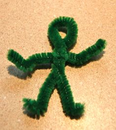 a green worry doll