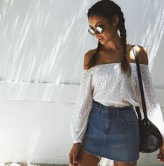 Denim skirt, off shoulder white top, black cross body bag