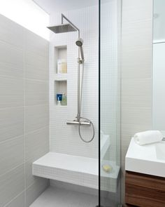 simple but this really works; mix of times. Wood and white. Big shower head. bench.