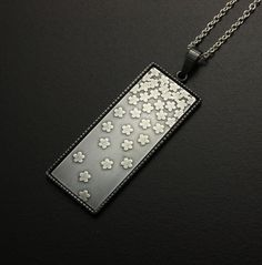 Falling blossoms rectangle silver pendant by KAZNESQ on Etsy, $340.00