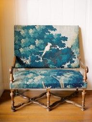 Cool idea, wrap a chair in fabric with am image on it. Maybe this with a orange instead of blue. So it would incorporate my accent color and the white would match the trim.
