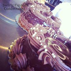 Chocolate shop cakes www.swirlzcustomconfections.com