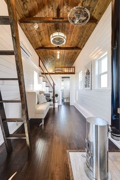 The white tongue-and-groove wall panelling and dark stained wood flooring and ceiling give the interior a contemporary finish.