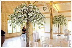 Brides little helper. These 8ft Wedding Blossom Trees add the WOW Factor to any wedding. They can be used for the ceremony at either side of the ceremony table, to mark an entra