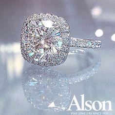 Beautiful diamond halo engagement ring!  6.17 round brilliant diamond surrounded by a cushion-shaped diamond halo.