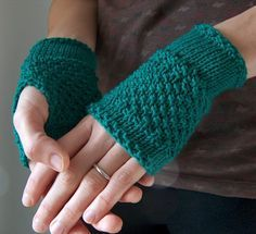 Free knitting pattern for Emerald Handwarmer easy fingerless mitts - creativeyarn created these easy handwarmers that are knit with Moss, Stockinette, Double Moss stitches. fingerless gloves wristers handwarmers wristwarmers