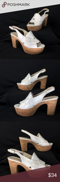 "White Patent Cork Platform Slingback Sandals Nine West White Patent ""Grace"" Cork Platform Slingback Sandals. New without box. White patent leather upper. Cork Platform heel. Rubber skid proof sole. Labeled a size 8 1/2 M. All man made materials. Measurements of the item in inches: Platform: 2"" Heel: 4"" Toe to heel: 9""  Feel free to contact me with any questions you may have. Please take a look at my other unique listings too. Thanks! Nine West Shoes Platforms"