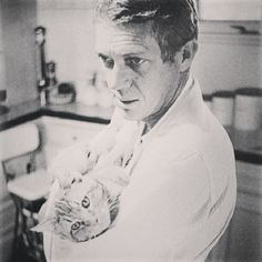 Steve with a cat in his arms. - @yotsuya21- #webstagram