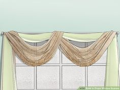 How to Drape Window Scarves. A window scarf, smartly hung, can highlight an entire room. It is like that final accessory that sets off the whole outfit. Use a window scarf to cover up a curtain rod, or install scarf hooks to hang a window. Scarf Curtains, Window Scarf, Window Drapes, Hanging Curtains, Window Coverings, Drapes Curtains, Window Treatments, Curtain Valances, Curtains Living
