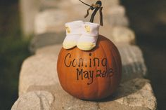 This would be cute, maybe have her hold the pumpkin?