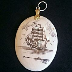 """WEEKEND SPECIAL  Real Ivory Scrimshaw Gold Pendant This 1 1/2"""" long oval real pre-ban ivory pendant has a high shine and is scrimshawed on one side with the iconic picture of a schooner and a musket. This is in Excellent vintage condition. The bale is 14k gold. This is a rare item which tons of collector value. Plus it's just beautiful. Vintage Jewelry Necklaces"""