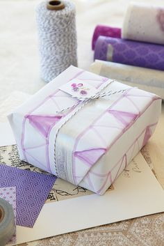 Amazing hand painted wrapping!! || Find more ideas here: www.selfpackaging.com